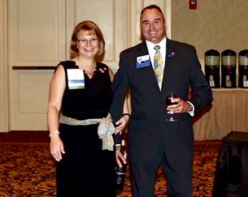 DG Jill and John Pietrusinski in the parade of Governors